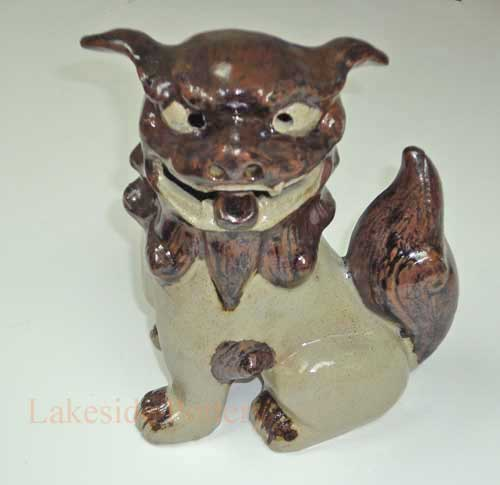 chinese dog statue repaired