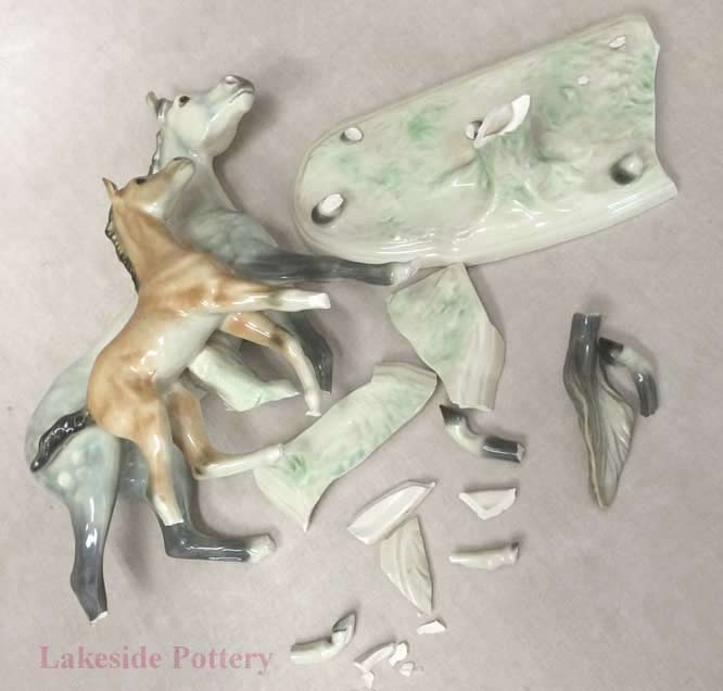 Broken ceramic horse and foal