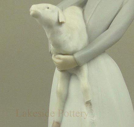 Llardo figurine -- girl with lamp mising leg and ear