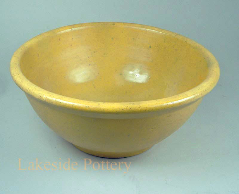 Restored early American stoneware bowl
