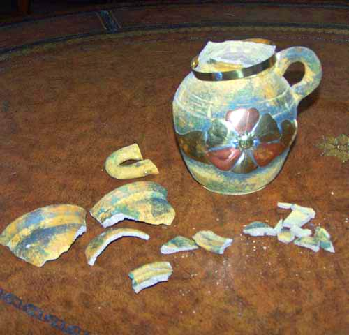 broken multimedia sedona terra cotta vase - broken