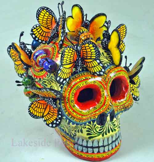butterflies mexican skull sculpture repaired